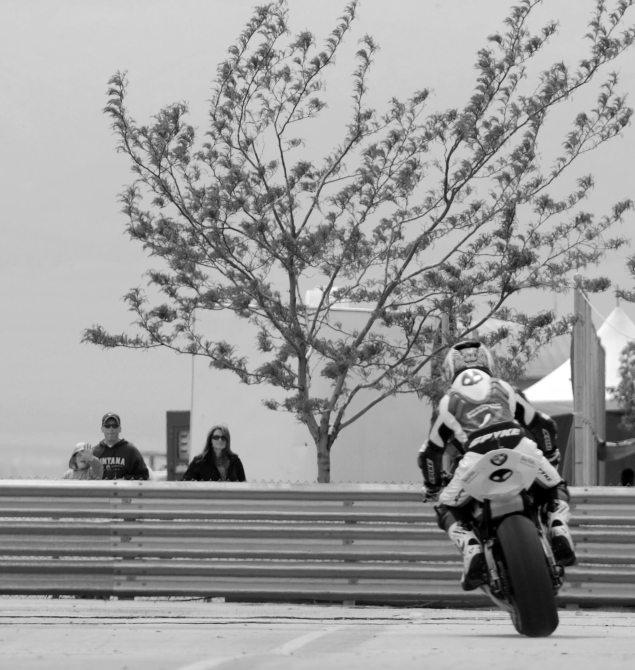 Asphalt & Rubber @ Miller Motorsports Park troy corser kid waving 635x670