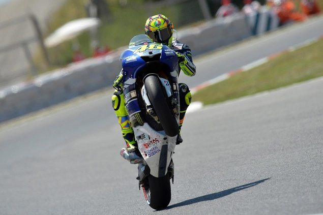 Friday Summary at Catalunya: Rossis Fastest Lap, Tire Troubles, & Crutchlows Future valentino rossi wheelie catalunya motogp yamaha racing 635x423