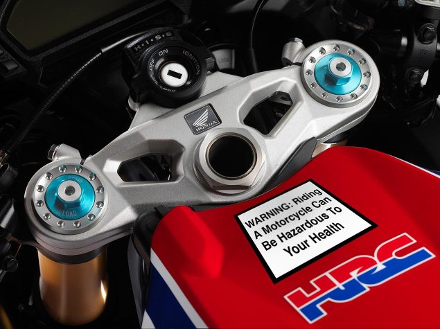California Law Mandates Tobacco Warning Labels To Be Put on All New Motorcycles Sold in State honda cbr1000rr warning label 635x475