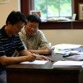 Tian Ma (l.) en Shouhong Wang