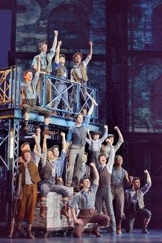 Dan DeLuca (Jack Kelly) (center) and the original North American Tour company of  NEWSIES. ©Disney. Photo by Deen van Meer.