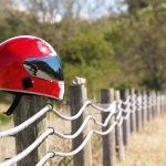 Motorcycle helmet on a fence