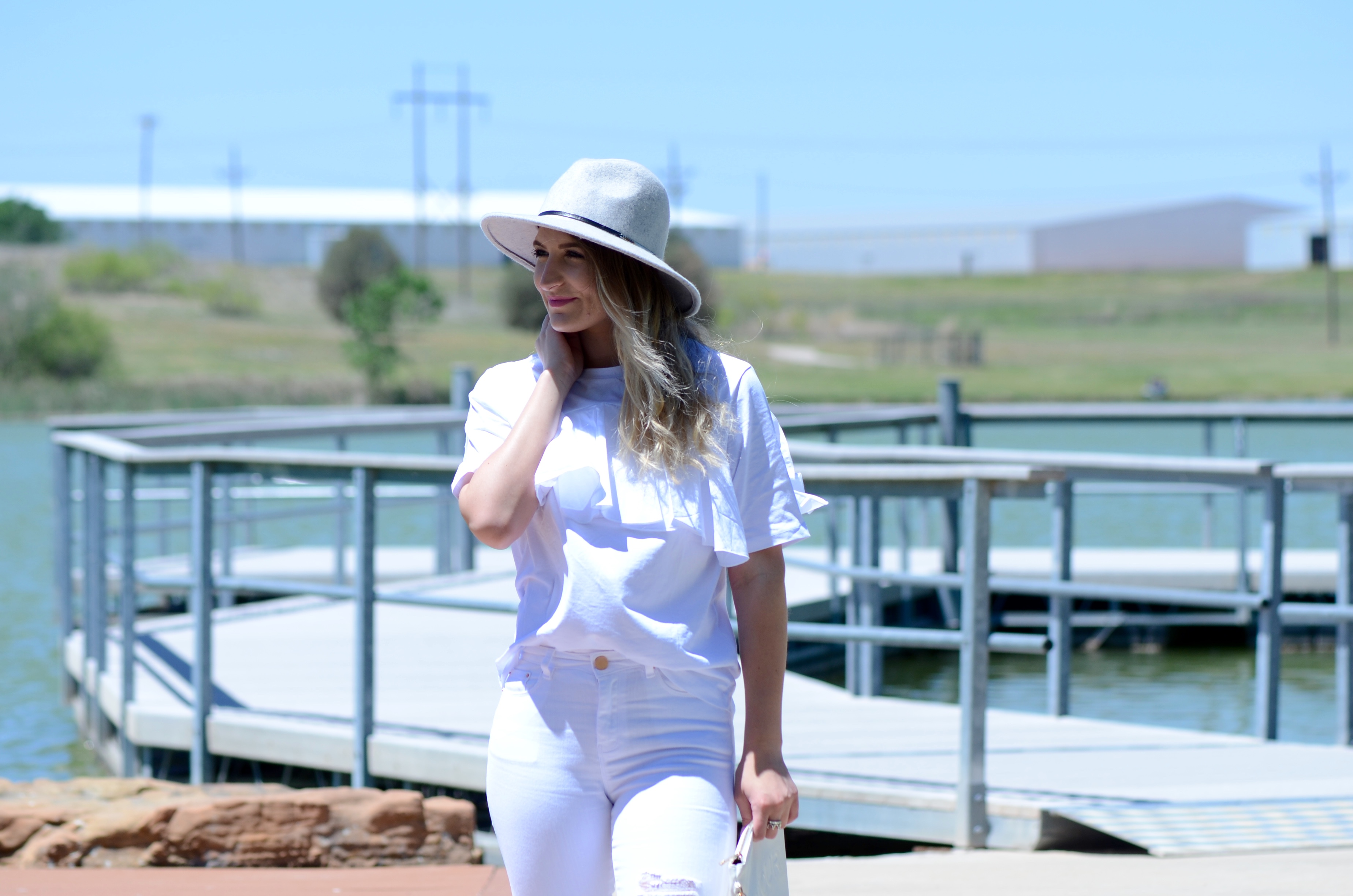 grey felt hat and an all white look