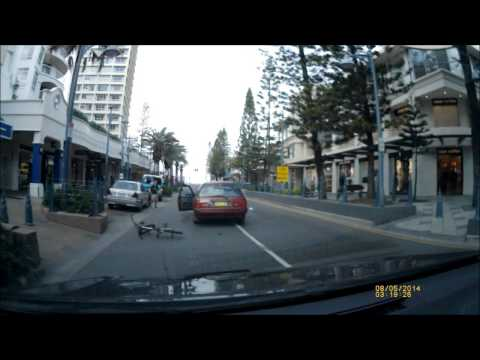 08-05-2014 - Cyclist get hit by car, lands on the roof and ends up back on his feet (Surfers Paradise, Gold Coast)