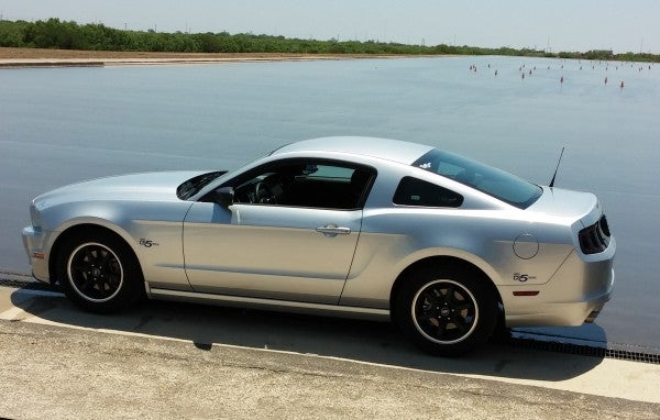 The silver Mustang with Cooper CS5 Grand Touring Tires, size 215/65R17.  A black Mustang was parked not far behind this one with Hankook H27 tires.