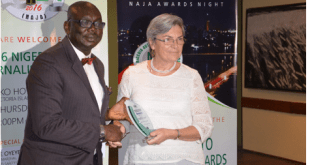 Mrs. Elizabeth Itegbe, GM for Weststar Associates Limited, sole distributors of Mercedes-Benz in Nigeria receiving awards at the recently-held NAJA Awards show at Eko Hotel and Suites., Victoria Island, Lagos