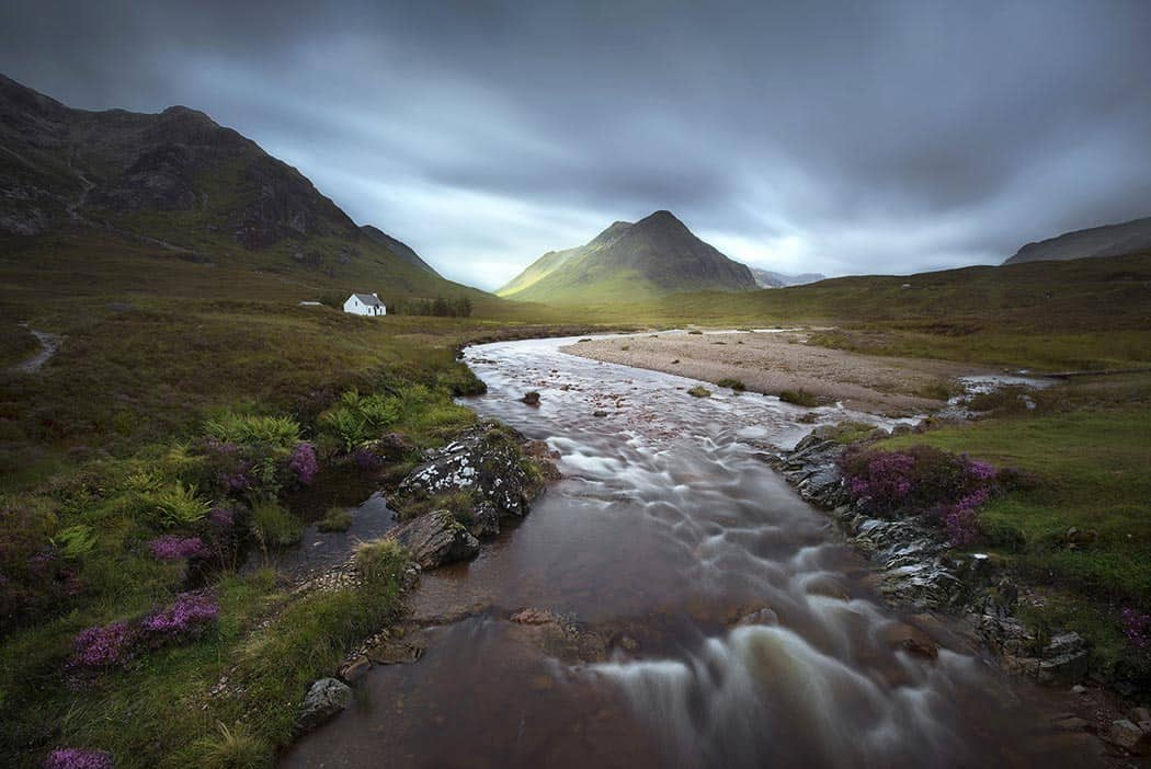 Glencoe mountains Scottish Highlands United Kingdom in a cloudy day. Click through to see 28 Mind Blowing Photos of Scotland - Avenly Lane Travel