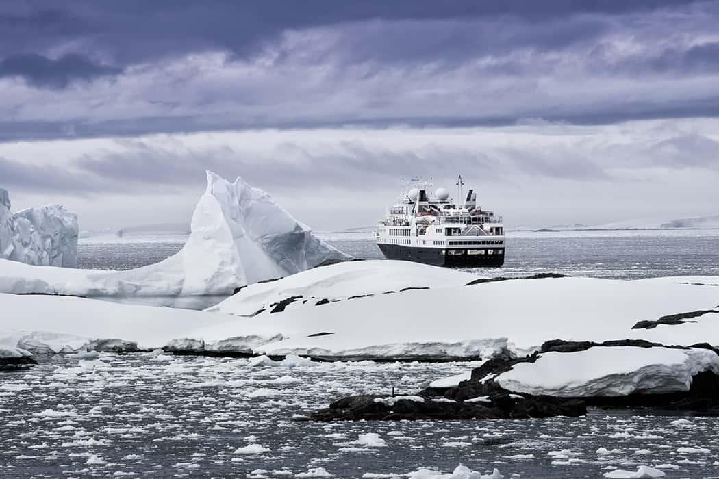 bigstock-Big-cruise-ship-in-the-Antarct-78745379resizefinal