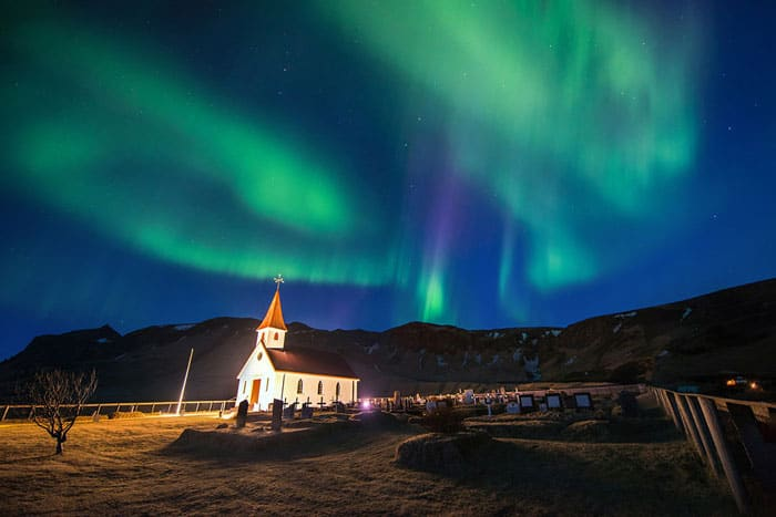 Northern lights over a church in Vik, Iceland!