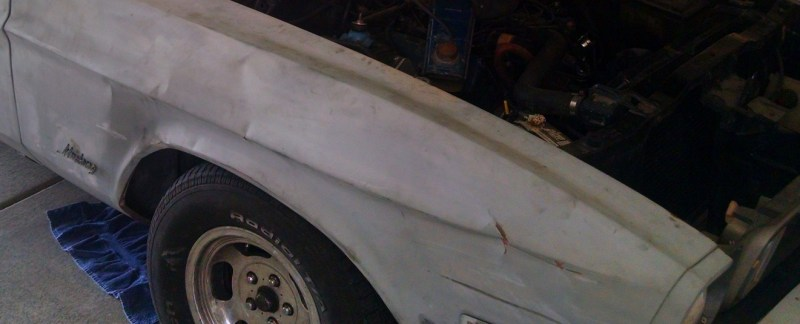 Right Side Fender - lots of crinkles, a few creases and good size dent.