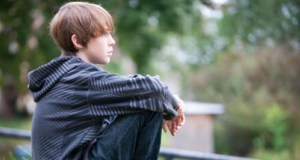 boy sitting alone featured image