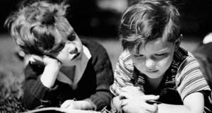 boys reading black white featured image
