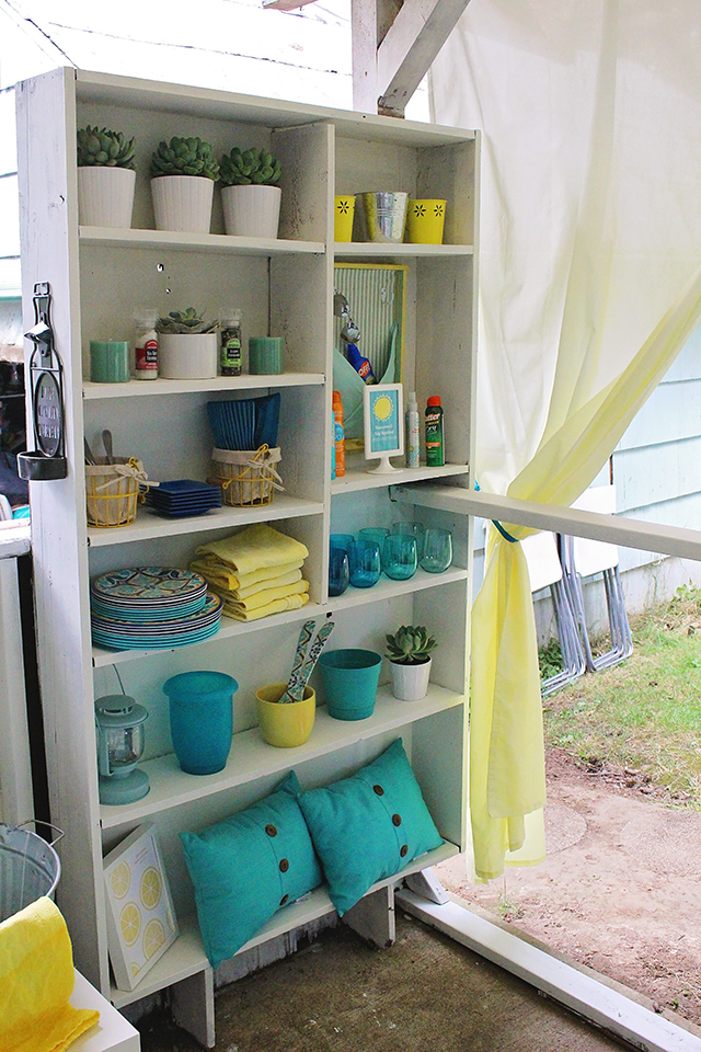 My porch bookshelf houses my many outdoor entertaining items in a neat and organized fashion.