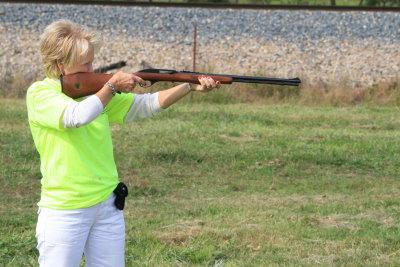 Woman shooting a rifle (Morgue File)