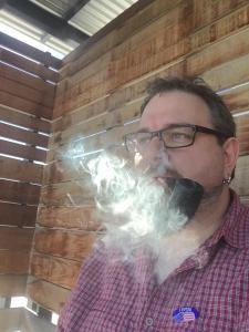 Magnus Smoking A Pipe