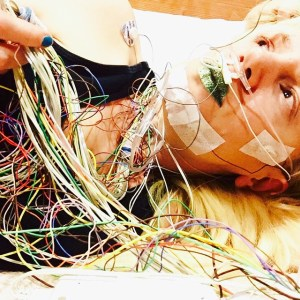 Karolyn Hooked up to a mass of wires for a sleep study