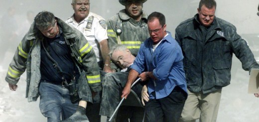 "Shannon Stapleton/Reuters /Landov A mortally injured Father Mychal Judge is carried out of the World Trade Center by first responders, including Bill Cosgrove (in white shirt). Cosgrove says, ""everybody you see in that picture was saved"" from the North Tower's collapse, moments later."