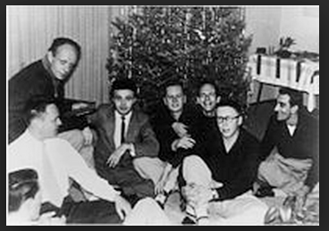 A rare rare group photograph of the Mattachine Society . Pictured are Harry Hay (upper left), then (l–r) Konrad Stevens, Dale Jennings, Rudi Gernreich, Stan Witt, Bob Hull, Chuck Rowland (in glasses), Paul Bernard. Photo by James Gruber.