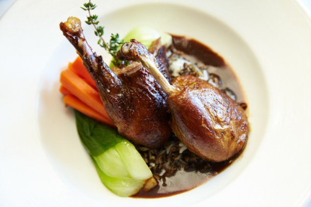 Duck Leg Confit: Salt-Cured duck w crispy skin, bacon beans and parmesan