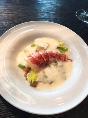 Butter Poached Lobster Tail: Roasted Potatoes, and crispy pancetta, in a white onion soubise