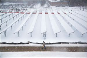 Snow-covered solar panels in Michigan.