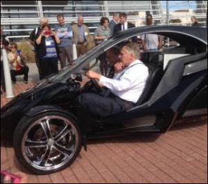 Governor McAuliffe checks out a made-in-Virginia three-wheeler outside the Virginia Beach Conference Center.