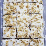 Carrot cake tray bake with cream cheese frosting and chopped walnuts - Baked to Imperfection
