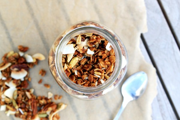 This Coconut Pecan Granola is a taste of the tropics that you can eat for breakfast! It's gluten-free and refined sugar free, and perfect for stirring into your yogurt or eating as a snack.