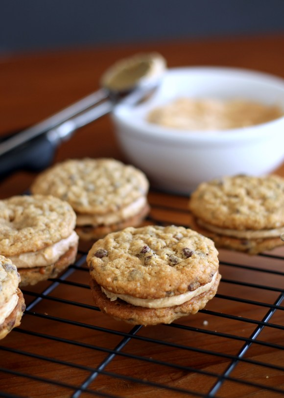 These Peanut Butter Oatmeal Chocolate Chip Cookie Sandwiches are chewy oatmeal cookies sandwiched with a creamy peanut butter frosting.