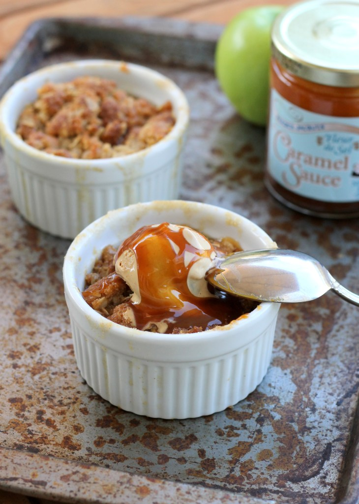 This Caramel Apple Crumble features spiced, caramel-coated apples and a deliciously crunchy & buttery crumble topping. This easy recipe is also gluten-free!