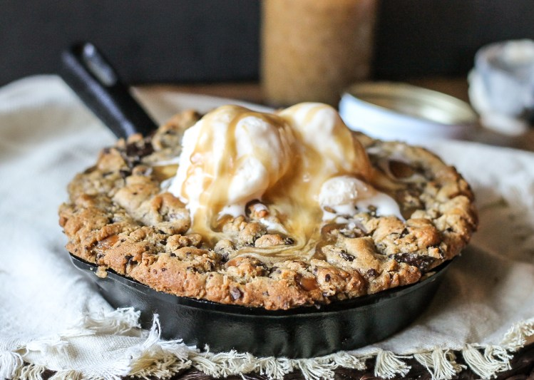 This Salted Caramel Filled Dark Chocolate Chunk Skillet Cookie is gooey, crunchy, and flowing with salted caramel! This is one treat best served with ice cream and friends.