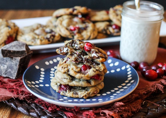 These Double Cranberry Dark Chocolate Chunk Cookies feature a browned butter and nutmeg dough studded with chocolate chunks & cranberries, both dried and fresh! They're the perfect addition to your holiday cookie platters. Recipe from Bakerita.com