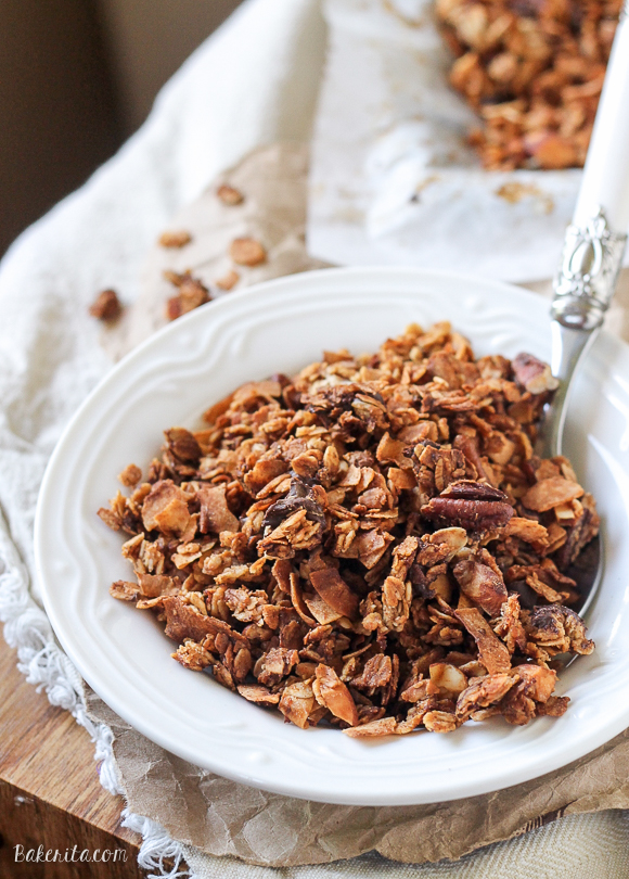 This Banana Coconut Granola tastes warm and tropical, and is full of crunch from the coconut flakes and pecans! It makes the perfect snack by itself, or mix it into some yogurt for the perfect breakfast.