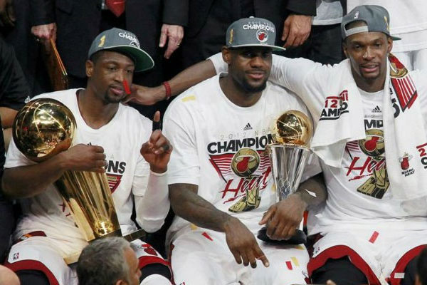 Dwyane Wade, Lebron James and Chris Bosh of the Miami Heat enjoy Finals victory