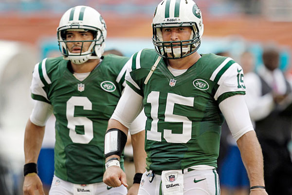 Mark Sanchez (left) and Tim Tebow (right)