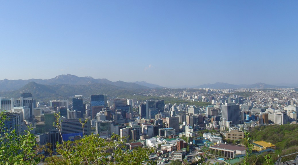 The skyline of Seoul with the hills in the background.