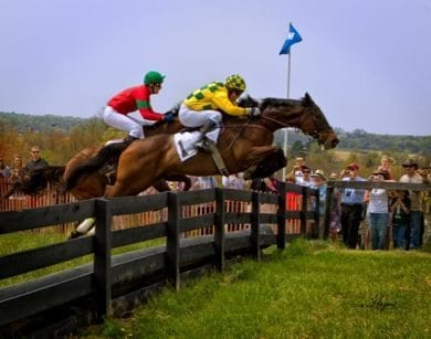 Winner INCOMPLETE (Joey Elliott) leads BON CADDO (Chris Read) at the last fence of the 2012 Manor.  Photo courtesy Maryland Steeplechasing.com