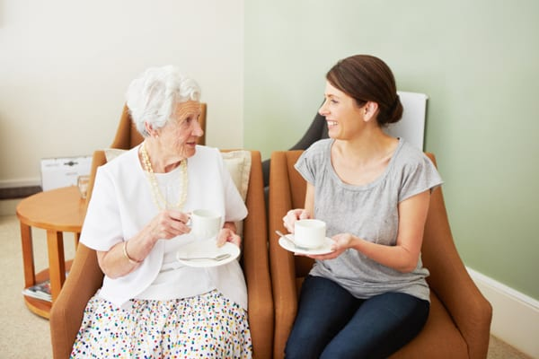 adult-grandmother-granddaughter-having-tea