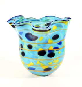 """Pictured: Tim McFadden, """"Multi-Color Vessel"""", Handblown Glass, Dimensions: 14 x 14 x 16 in. Price: $1,200.00 Give the gift that resonates throughout the year with a unique piece of art. Tim McFadden is a Maryland based artist who employs intricate blown glass techniques to create his beautiful vessels. Each organically shaped piece is made exclusively by hand, a beautiful one of a kind centerpiece in any home.- Renaissance Fine Arts"""