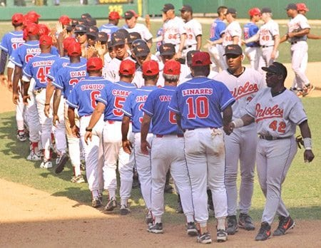 Orioles and Cuba shake hands, circa 1999.