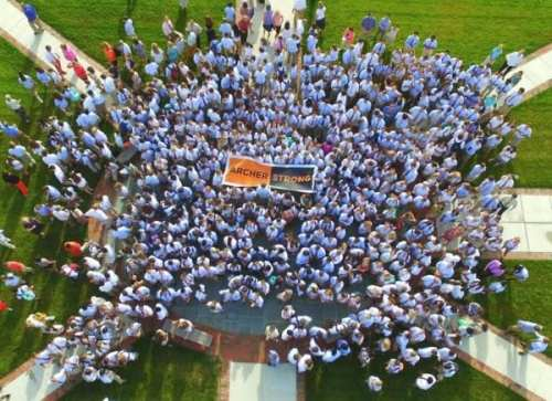 Drone-captured image of McDonogh student body displaying Archer Strong sign
