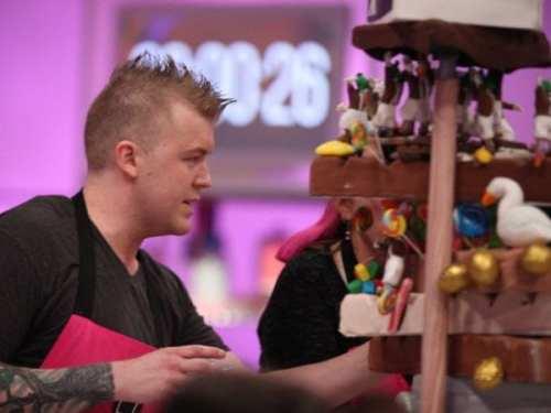 Jason puts the finishing touching on his winning Willy Wonka cake.
