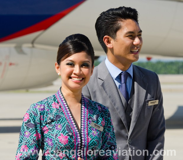 """In the humid, sticky heat, it was amazing to see how the Malaysia Airlines cabin crew of Ms. Nur Syaza and Mr. Shahrulufti kept their cool and make-up intact, despite being in full uniform. Incidentally, Malaysia Airlines has won the """"World's Best Cabin Staff"""" award from Skytrax seven of the last 11 years."""