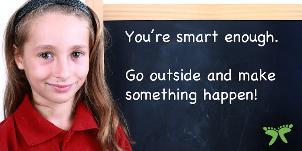 Girl with chalkboard wisdom