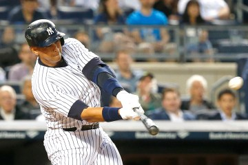 Bronx, New York  5/07/15 Alex Rodriguez #13 of the New York Yankees hits a solo home run during the third inning for his 661 home run of his career passing Willie Mays on the MLB All-Time home run list in a baseball game at Yankee Stadium on May 7, 2015  (Paul J. Bereswill)