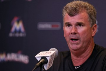 MIAMI, FL - MAY 18: New manager Dan Jennings #26 of the Miami Marlins talks to the media after the loss against the Arizona Diamondbacks at Marlins Park on May 18, 2015 in Miami, Florida.  (Photo by Rob Foldy/Getty Images)