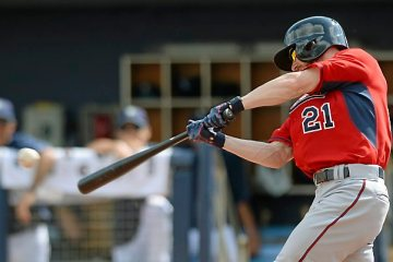 Twins outfielder Shane Robinson hits a single against Tampa Bay pitcher Brandon Gomes in the fifth inning at Charlotte Sports Park in Port Charlotte, Fla. on Friday, March 6, 2015. The Ray beat the Twins, 2-1. (Pioneer Press: John Autey)