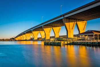 A bridge crosses over waterfront buildings in Kent Narrows, MD