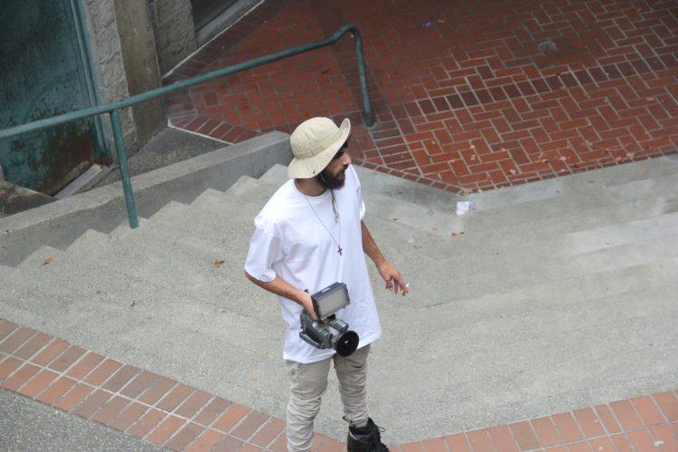 JOSIAH BLEE - SMOKE BREAK DURING A FILM SESSION - PHOTOGRAPH BY SAM ASKEN