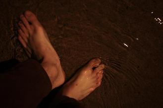 Eight ten. I pause in a street side stream, and catch water with my feet.